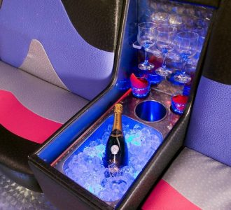 limo interior seating and champagne bucket with glasses