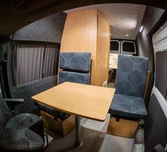 van conversion wooden interior with chairs