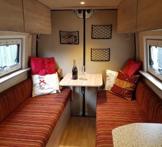 van conversion interior seating and pull out table with cushions
