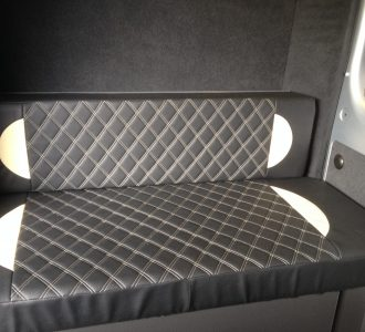 black and white quilted leather seating