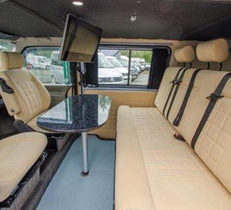 van conversion cream interior and tv