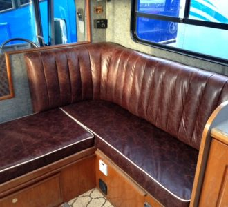 brown leather seating with wooden accent