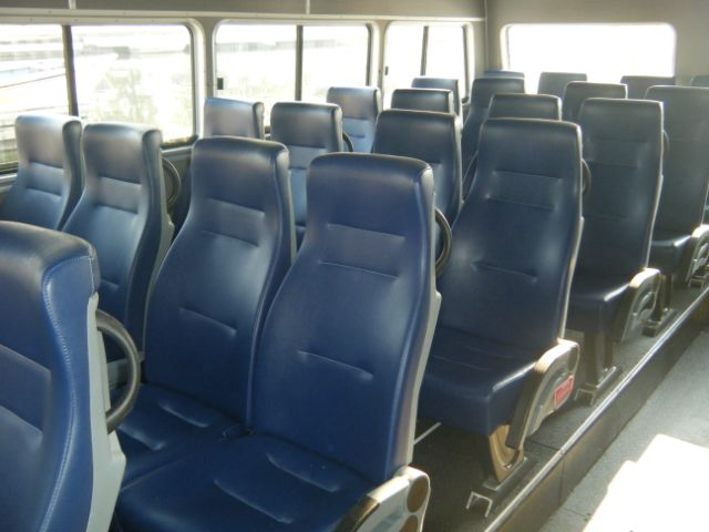 rows of blue leather bus seating
