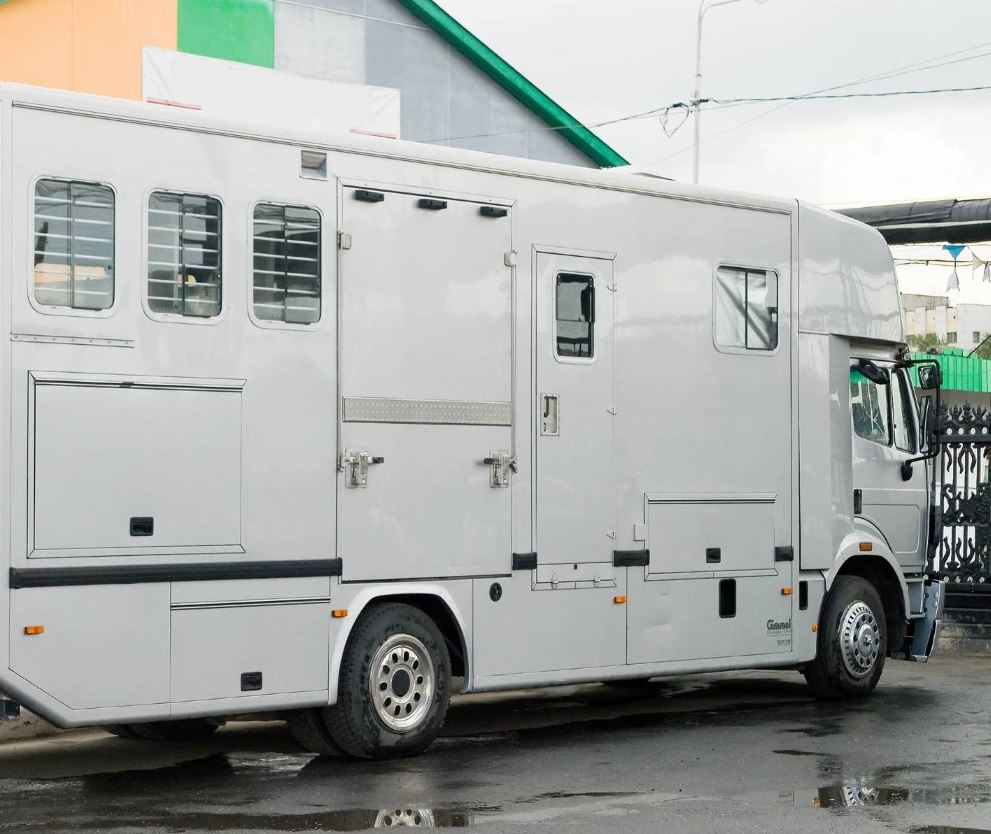 large white horse box van